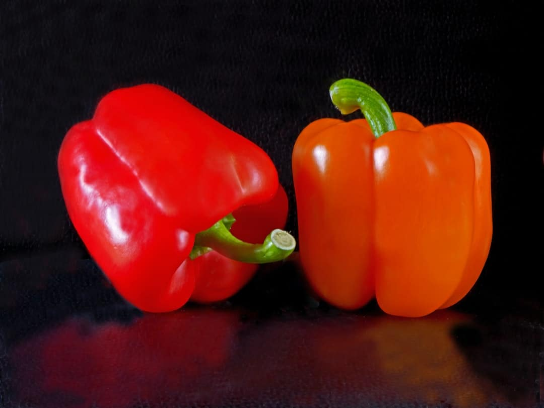 A pepper cut in half and sitting on a table