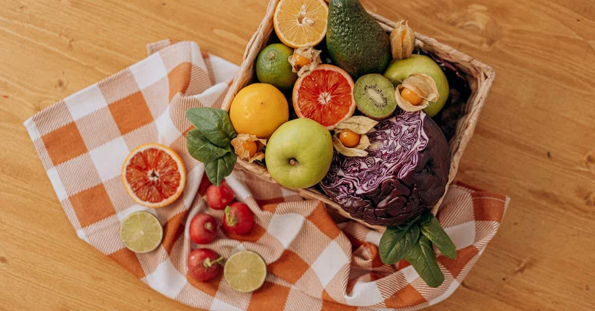 A plate of fruit sitting on top of a wooden table