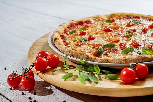 A pizza sitting on top of a wooden table