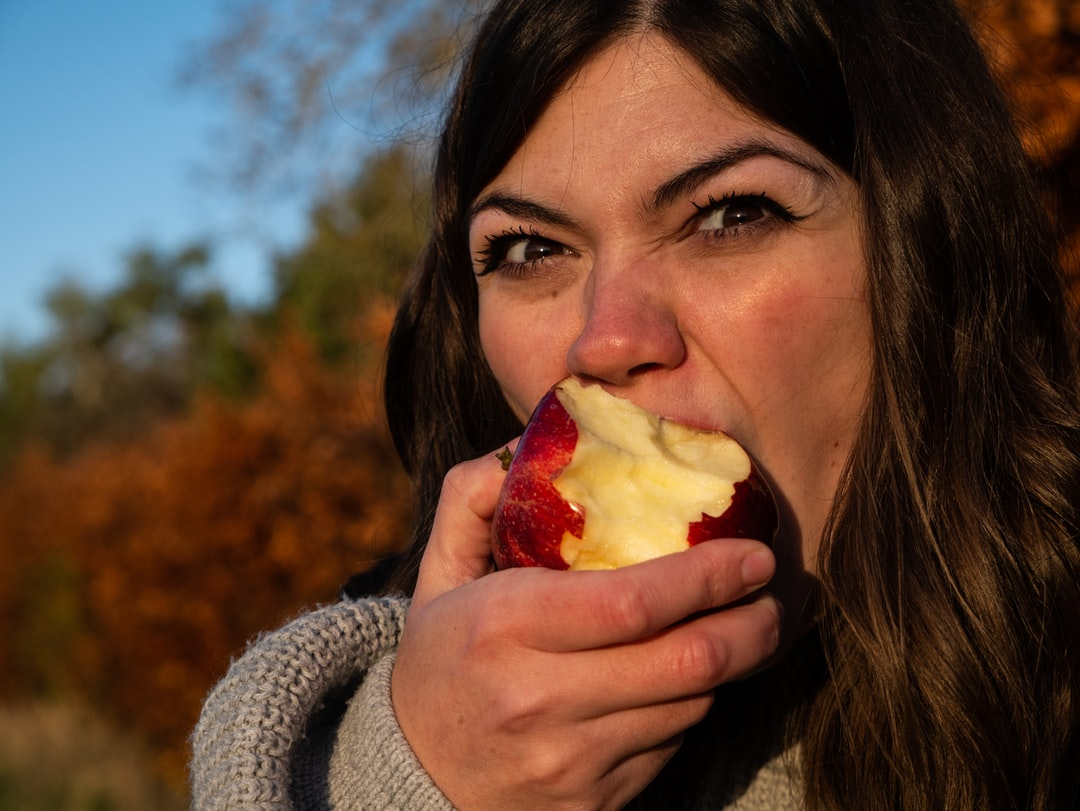 A close up of a woman eating food