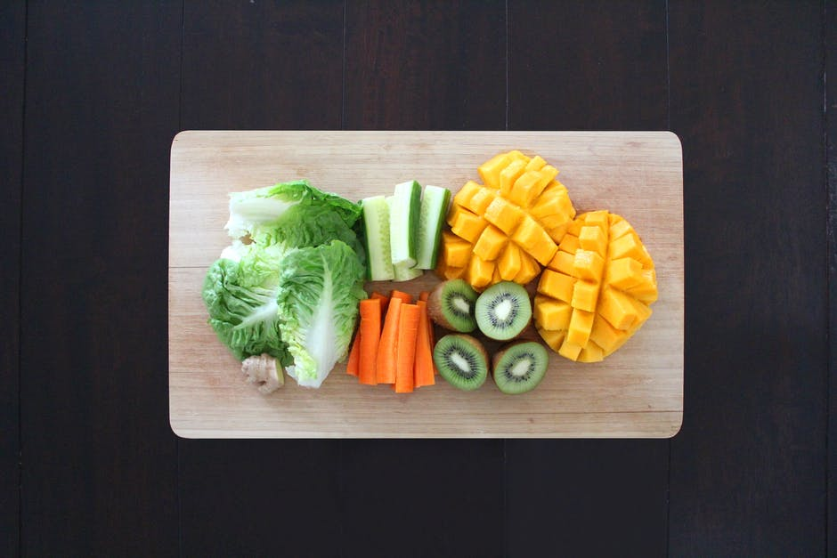 A bunch of food sitting on a wooden cutting board